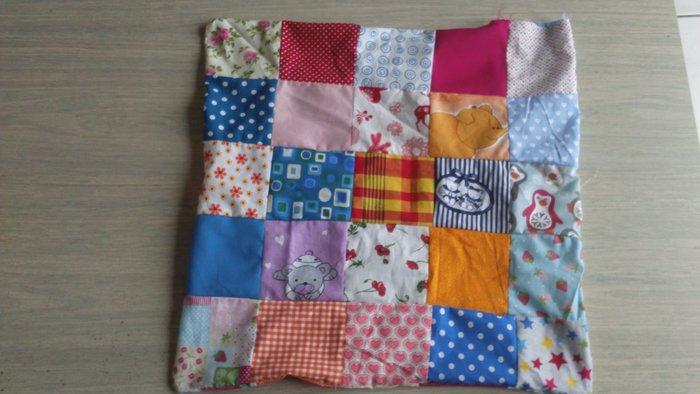 Coussin patchwork- Retourner l'ouvrage