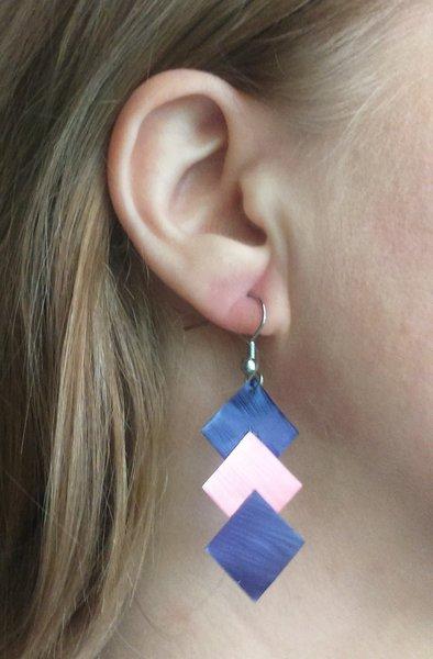 Boucles d'oreilles en capsule recyclée-port des boucles d'oreilles