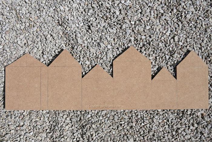Un porte manteau original bois et métal-Dessiner et découper le décor avec les maisons